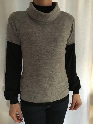 Grauer Pullover mit schwarzen Ärmeln Gr S