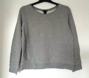 Grauer Pullover Sweater