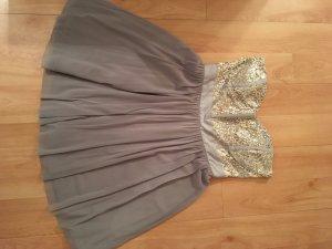 Graues Partykleid mit silbernen Pailletten