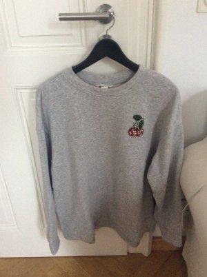 Graues Sweatshirt mit Glitzer- Applikation