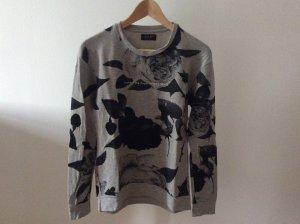 Graues Sweatshirt mit Muster von Zara