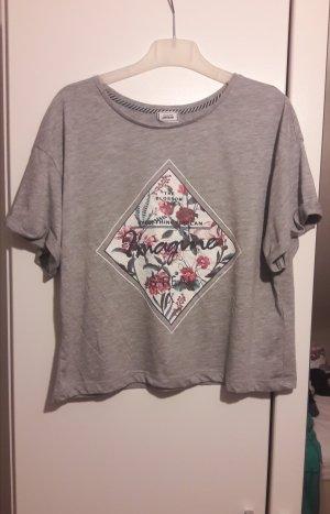 Graues T-Shirt mit Blumenaufdruck