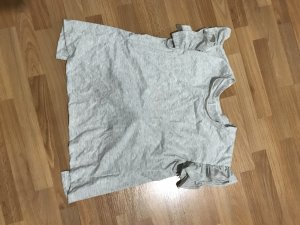 Graues Tshirt mit Rüschen und freiem Rückenausschnitt