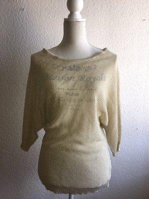 Grobgestrickter goldener Pullover mit Glitzerdetails