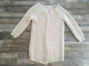 Zabaione Veste tricotée en grosses mailles crème