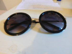 Große runde Sonnenbrille mit Goldelelementen