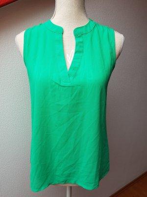 Grüne Bluse mit V-Ausschnitt