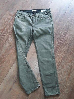 Grüne Skinny Jeans mit Goldeffekt