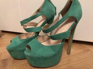 Plateauzool pumps groen