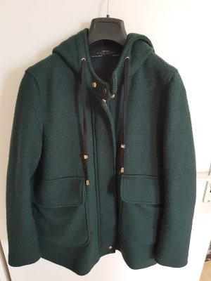 grüner Mantel