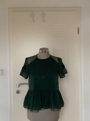 Grünes Oberteil mit durchsichtigen  Schultern