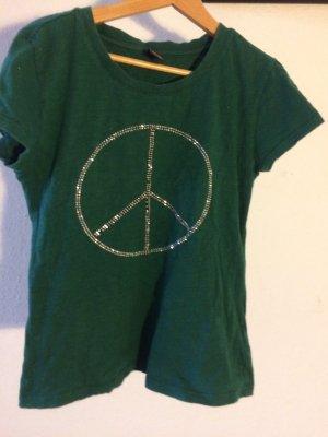Grünes T-shirt mit Peace-Zeichen und Glitzer