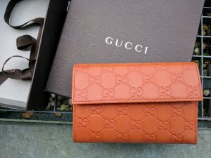 Gucci Portefeuille beige cuir
