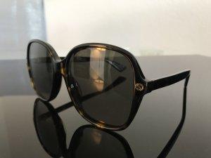Gucci Occhiale da sole ovale marrone Materiale sintetico