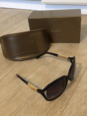 Gucci Ronde zonnebril zwart-lichtbruin