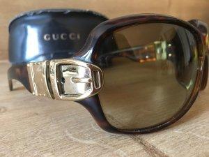 Gucci Sonnenbrille mit typischer Signatur Schließe als Zierde
