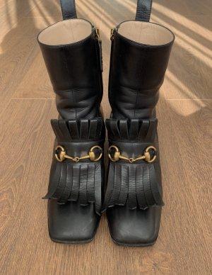 Gucci Halfhoge laarzen zwart-goud