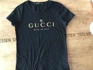 Gucci T-Shirt in schwarz mit goldenem Logo