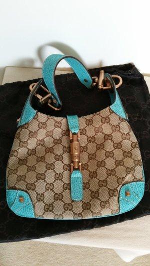 Gucci Tasche GG Canvas und türkisfarbenes Leder