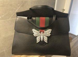 Gucci Tasche mit Gucci Lippenstift