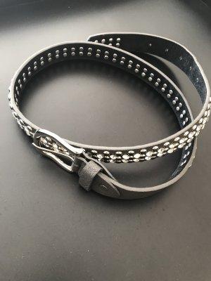 Cinturón de pinchos taupe