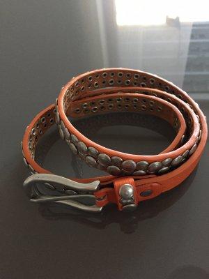Cinturón de pinchos naranja