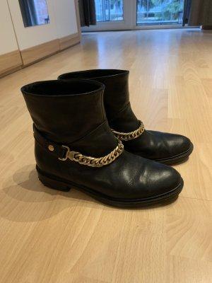 Guess Botas negro-color oro Cuero