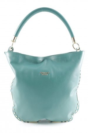 Guess Bolso barrel azul cadete look casual
