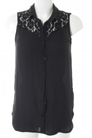H&M Divided ärmellose Bluse schwarz florales Muster Business-Look