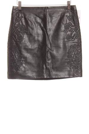 H&M Kunstlederrock schwarz abstraktes Muster Biker-Look