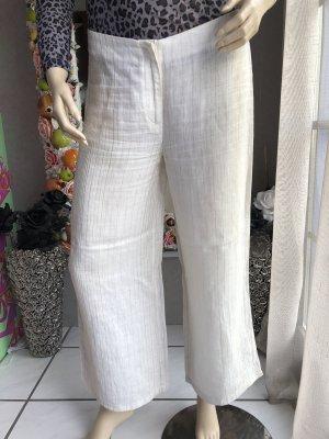 H&M Pantalón de lino color oro-blanco puro