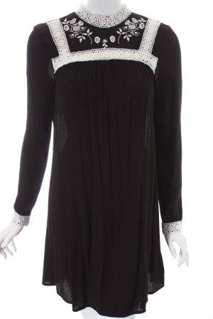 H&M Tunikabluse schwarz-weiß florales Muster Romantik-Look
