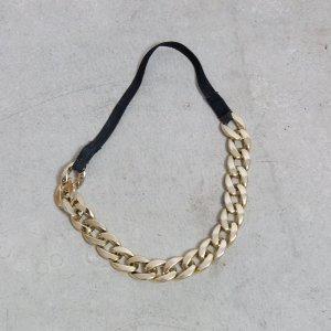 Accessorio per capelli nero-giallo-oro