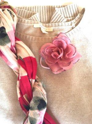 Accessoire pour cheveux rose