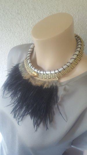 Cadena negro-color oro