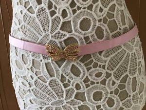 Cinturón pélvico color oro-rosa