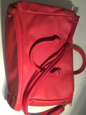 Handtasche in himbeerrot
