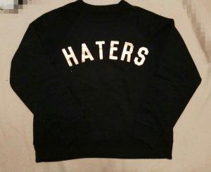 Haters gonna hate! Schwarzer Pullover mit goldener Schrift