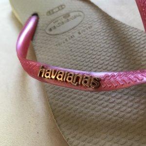 Havaianas Flipflops mit rosegoldenem Logo