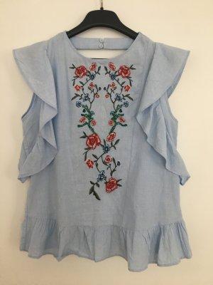 Hellblau geblühmte Bluse