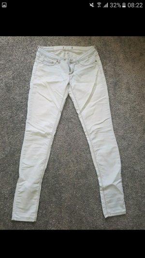 Hellblaue dünne Jeans