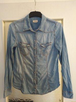 Hellblaue Jeansbluse mit Druckknöpfen