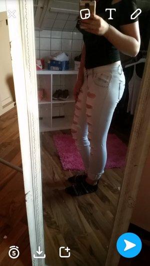 hellblaue riss-Jeans