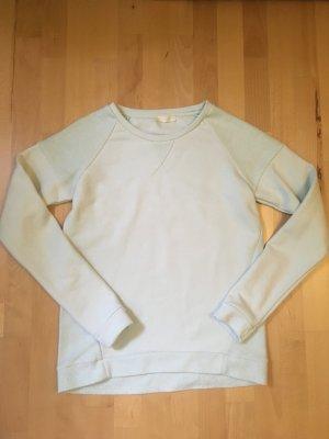 Heller, türkisfarbener Pullover