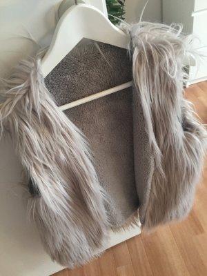 Smanicato di pelliccia grigio chiaro