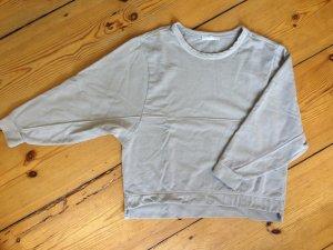 Hellgraues Sweatshirt mit weitem Ärmel