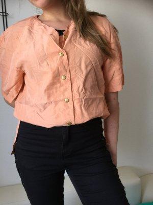 Blusa in seta albicocca