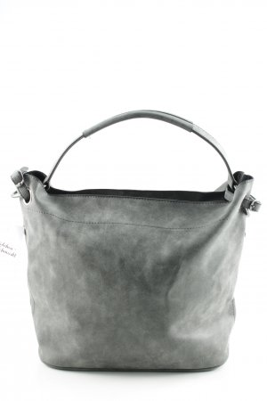 Bolso barrel gris look casual