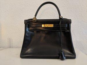 Hermès Bolso azul oscuro Cuero