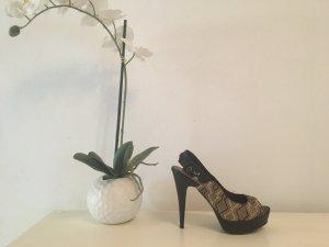 Sandalo alto con plateau nero Finta pelle